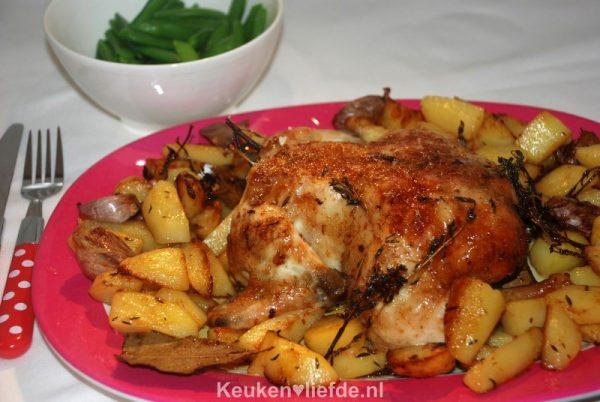 Gebraden hele kip uit de oven met aardappels