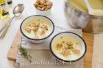 Knolselderijsoep met truffelolie en croutons