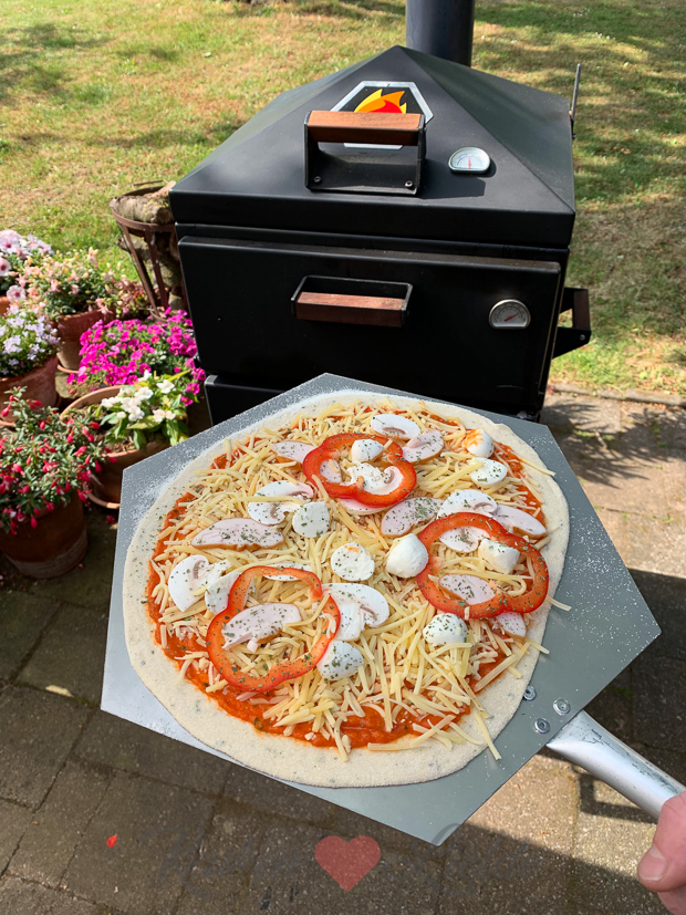 Pizza bakken in een houtoven: tips en trics + recept